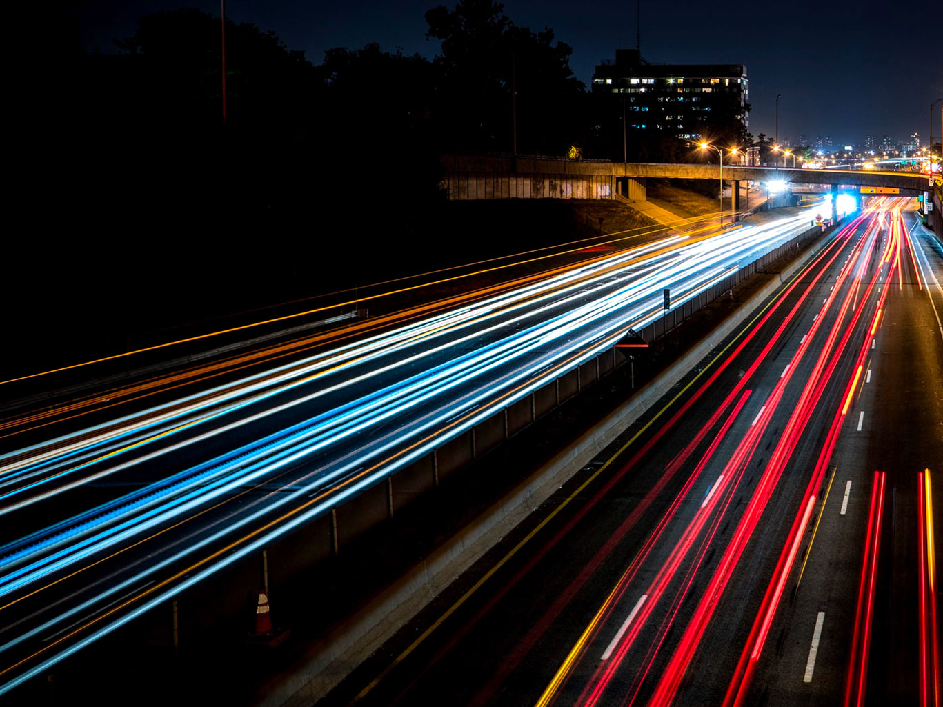 long-exposure shot of car lights on highway