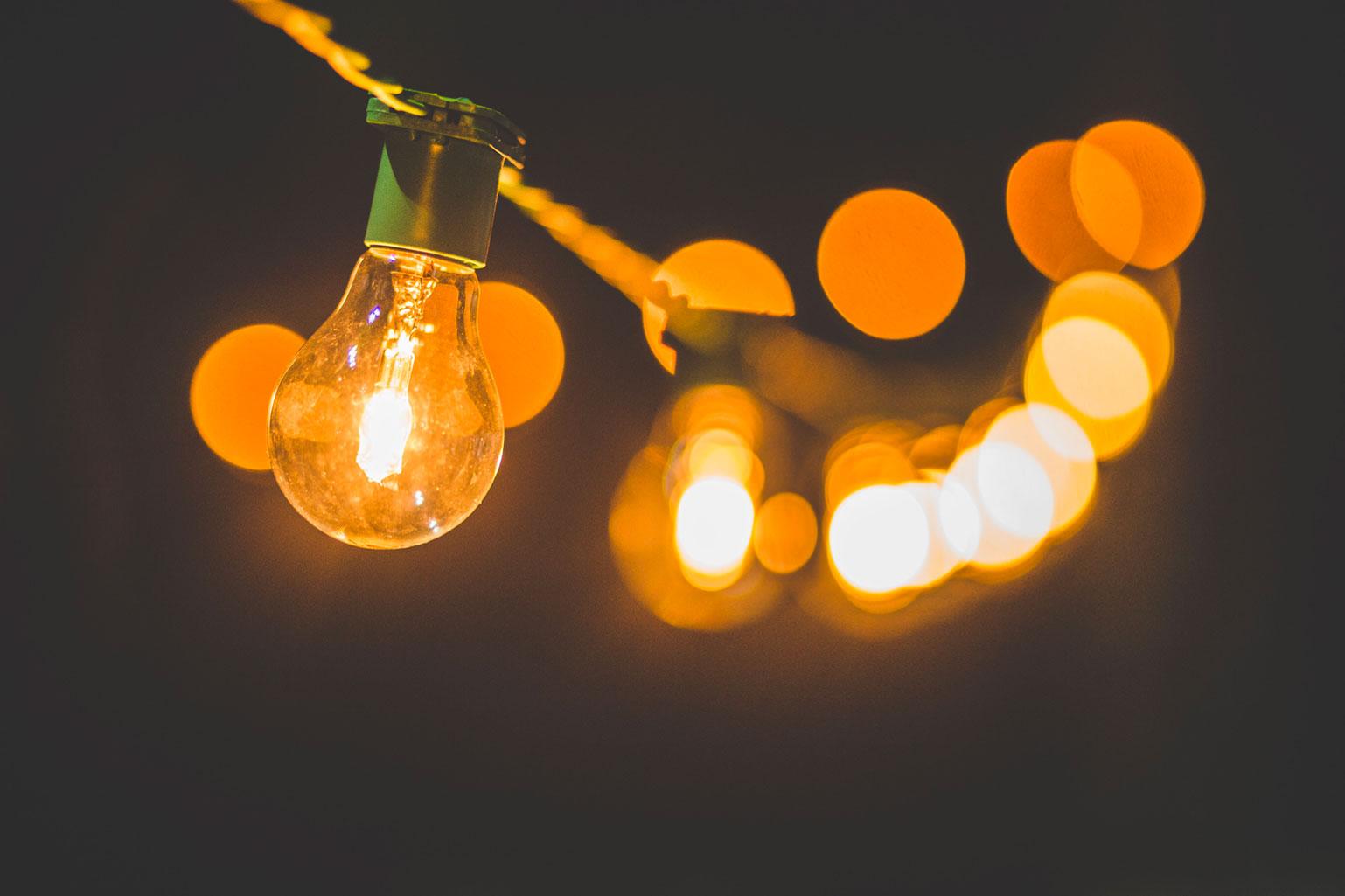 string of light bulbs in dark