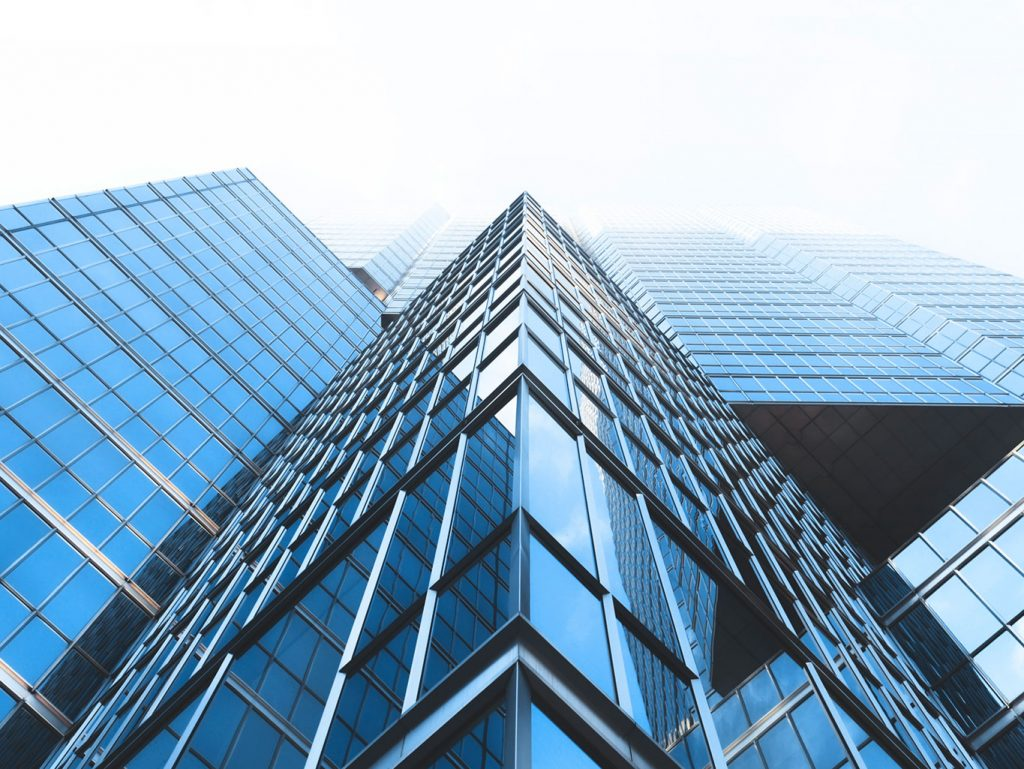 photo from street of tall glass building