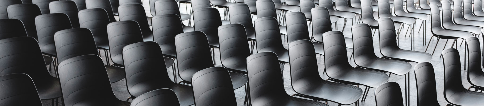 rows of empty grey chairs